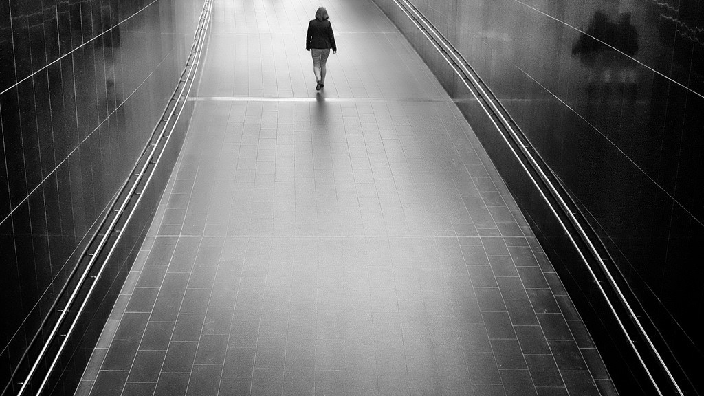 Girl on deserted corridor