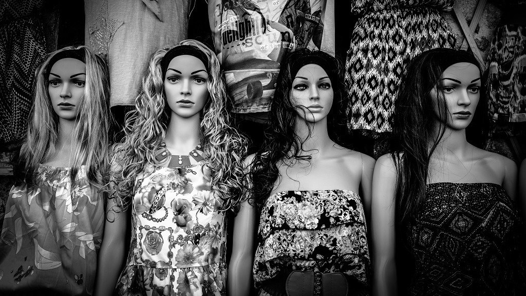 Collection of female mannequins wearing different dresses